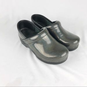Dansko black iridescent professional clogs.